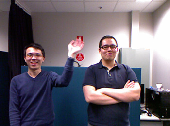 two testers, one with his hand up